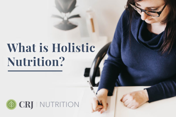 'What is Holistic Nutrition?' text on top of a photo of Courtney writing a nutrition consult